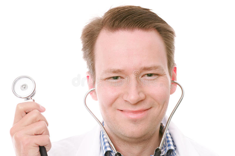 Happy doctor. Happy young senior consultant holding his stethoscope - on white stock photo