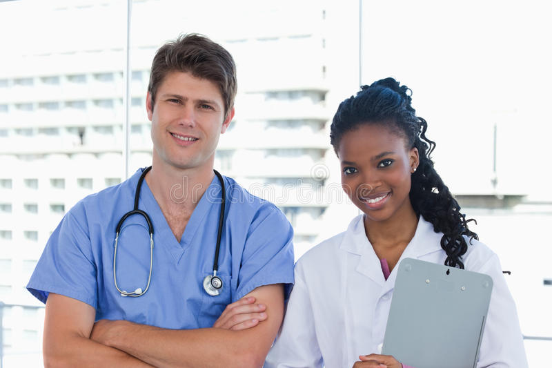 Download Happy doctors posing stock photo. Image of clipboard - 22692846