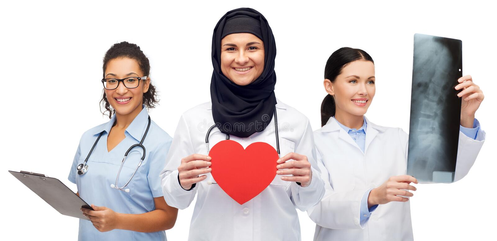 Happy doctors with red heart, x-ray and clipboard royalty free stock photos