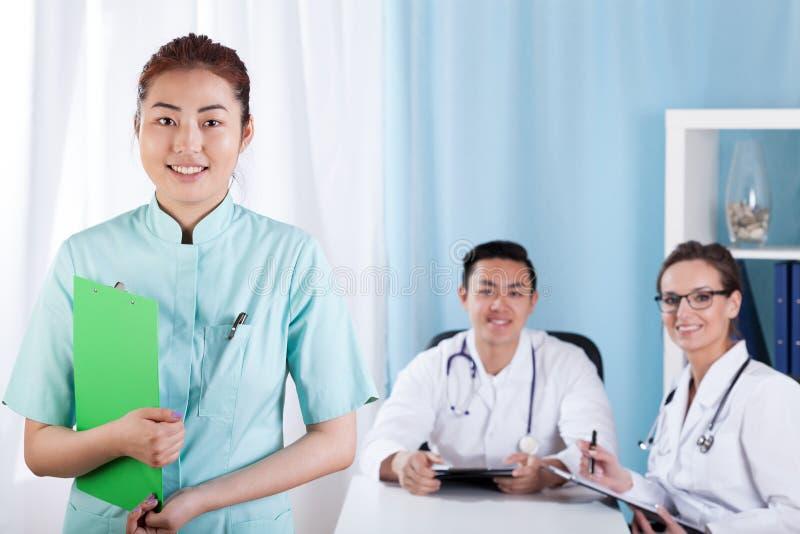 Happy doctors team before work royalty free stock image