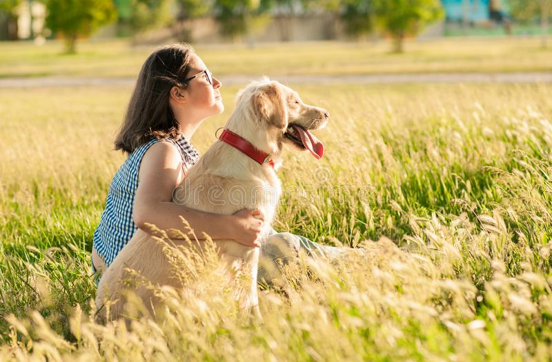 Happy dog and owner enjoying nature in the park royalty free stock image
