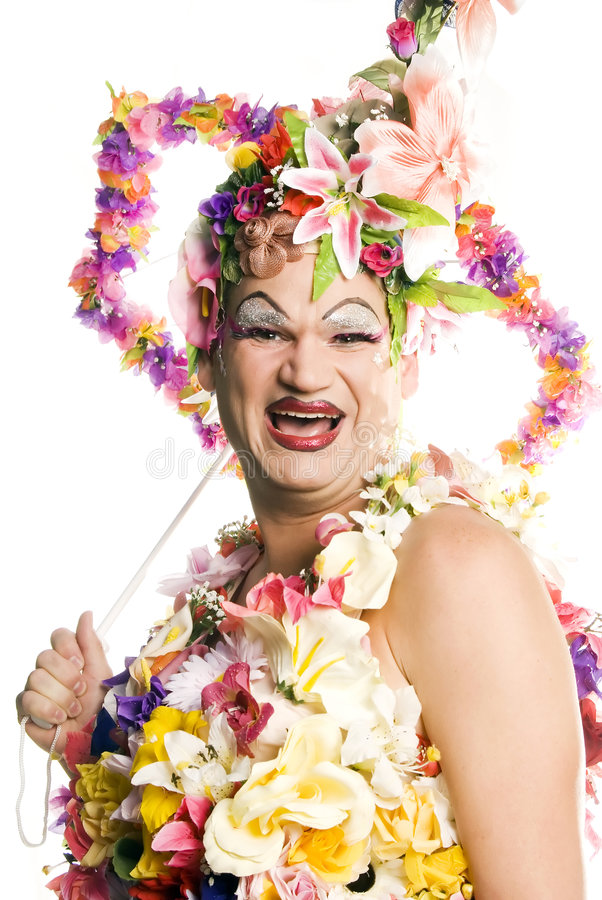 Happy Drag Queen. This image shows a drag queen dressed in a very festive flower outfit