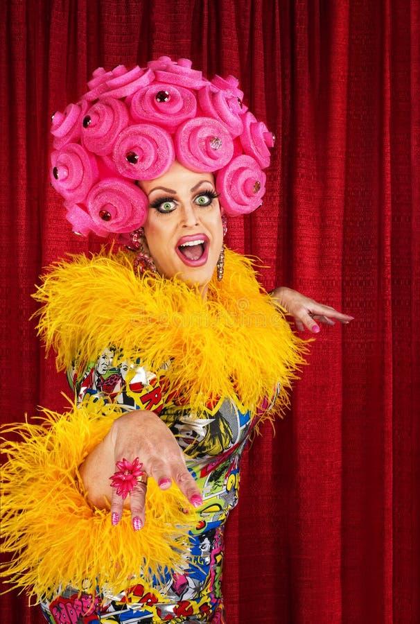 Happy Drag Queen. Happy dancing drag queen in pink foam wig stock images