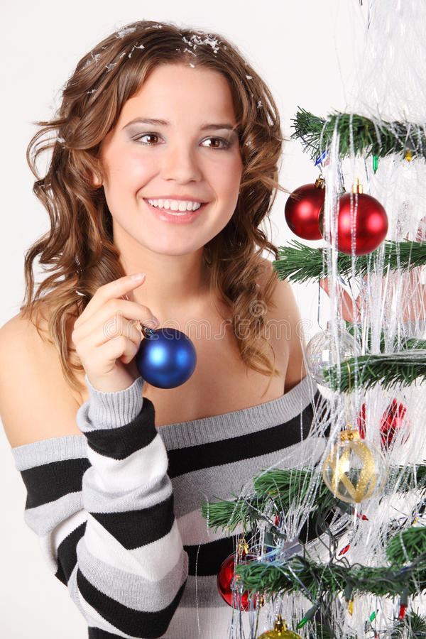 Happy, dreaming girl in sweater holds glass ball stock photo