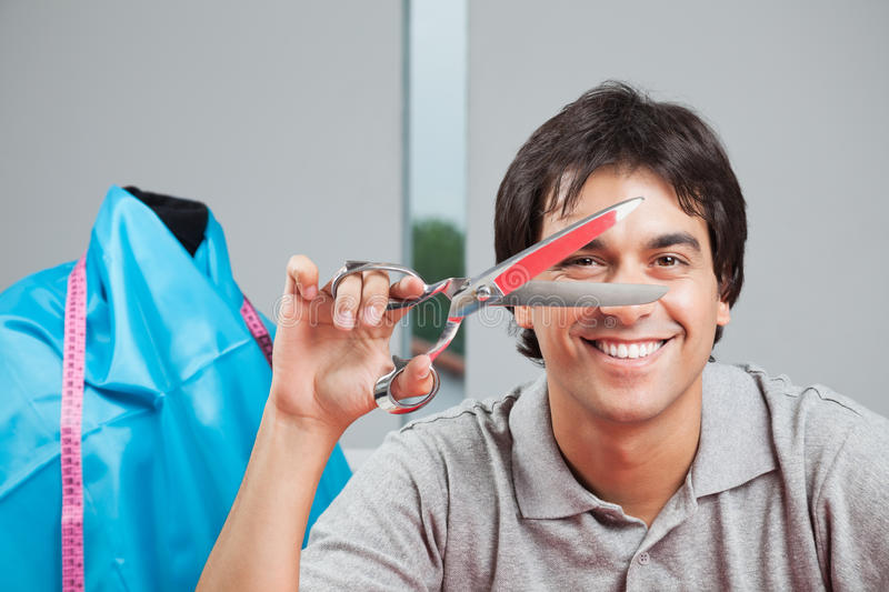 Happy Dressmaker Holding Scissor stock photos