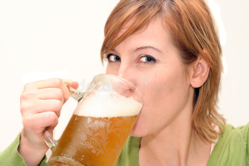 Happy drinking beer royalty free stock photography