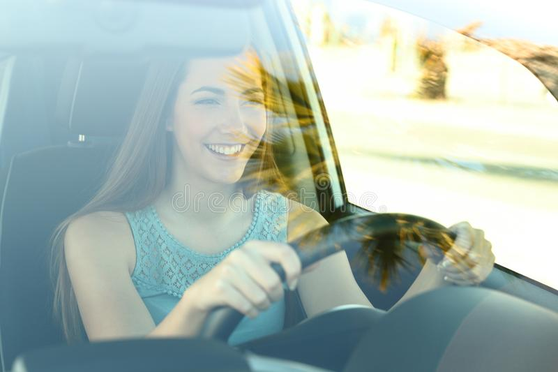 Happy driver driving a car stock photography