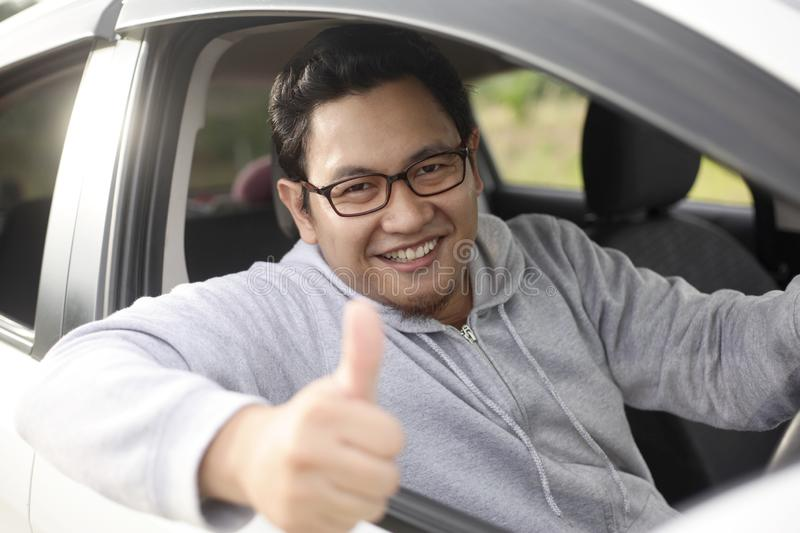 Happy Driver Shows Thumb Up and Smile royalty free stock photography