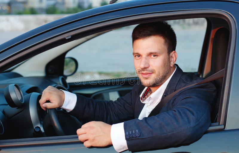 Happy driver. Smiling man in the car, happy driver royalty free stock photography