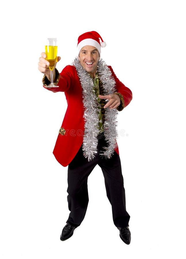 Happy drunk rake senior businessman in Champagne Christmas toast party at work wearing Santa hat. Happy drunk rake senior businessman in Champagne Christmas stock photo