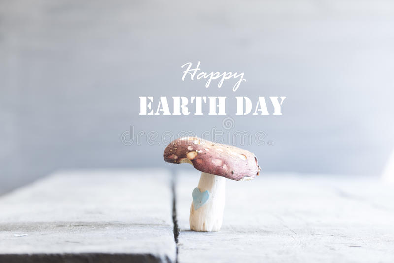 Happy Earth Day card. Text, and mushroom with heart stock photography
