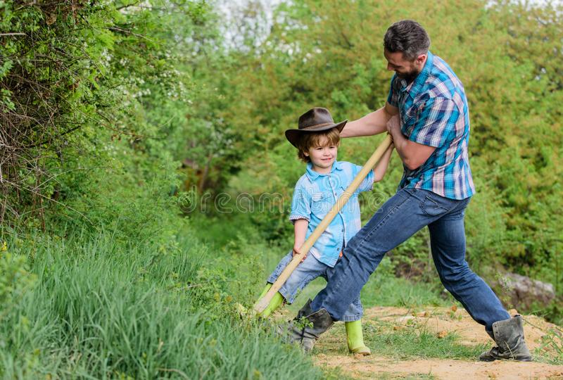 Happy earth day. Dig grounf with shovel. rich natural soil. Eco farm. Ranch. small boy child help father in farm. new. Life. soils fertilizers. father and son royalty free stock photos