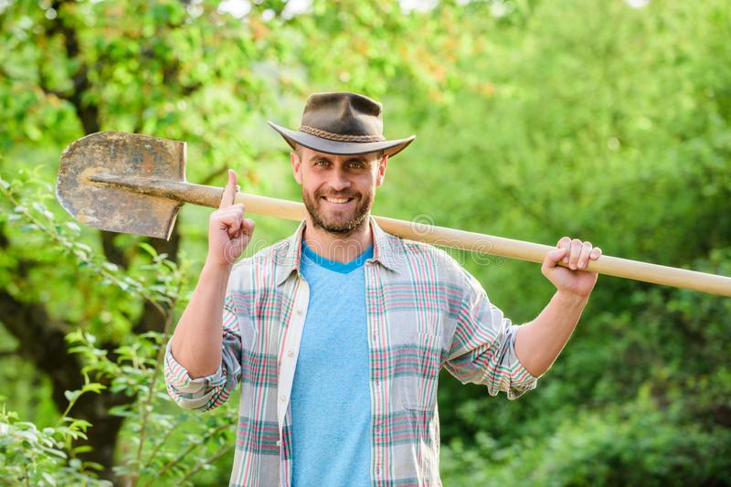 Happy earth day. Eco living. farming and agriculture cultivation. Garden equipment. muscular ranch man in cowboy hat stock photo