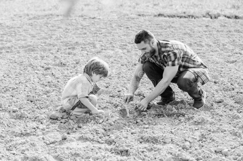 Happy earth day. Family tree. father and son planting flowers in ground. small boy child help father in farming. earth. Day. new life. soils fertilizers. rich stock photo