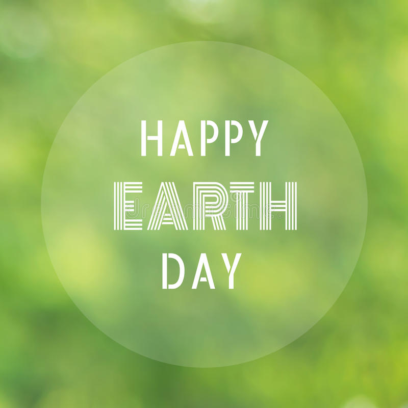 Happy Earth Day letter blurred nature background stock photography