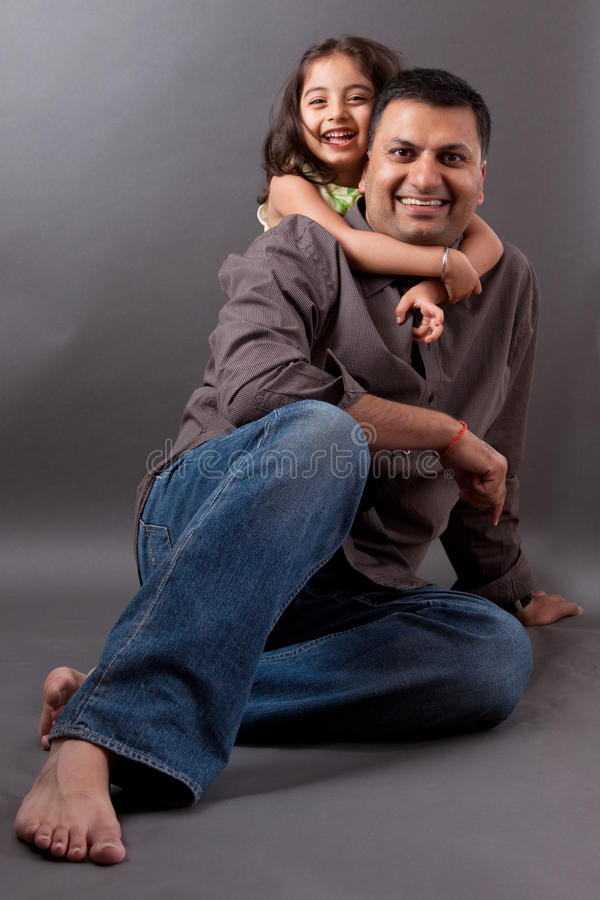 Happy East Indian man with his daughter royalty free stock image