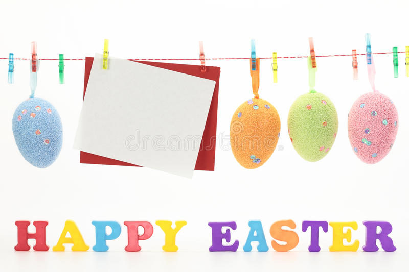 Happy Easter. Easter card and eggs hanging on the clothesline stock photo