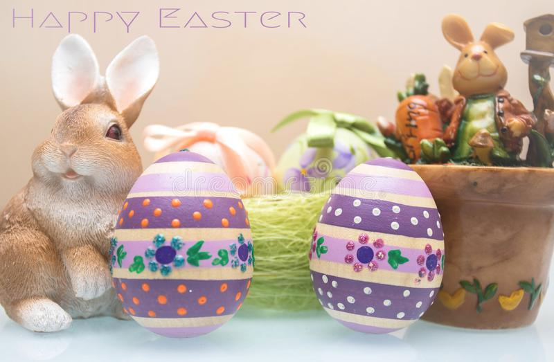 Happy Easter! Background with colorful eggs in basket and bunny for holiday stock photography