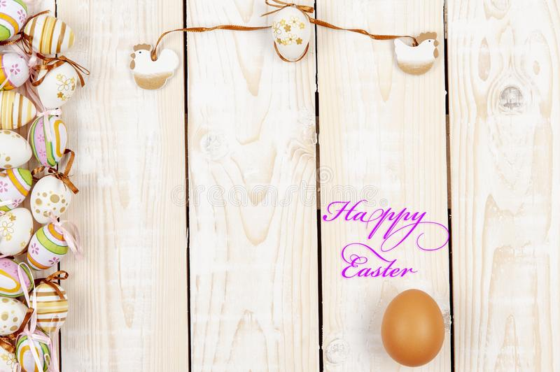 Happy easter background in the pastel color and on the wood.  royalty free stock photos