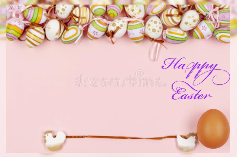 Happy easter background in the pastel color and on the wood.  royalty free stock image