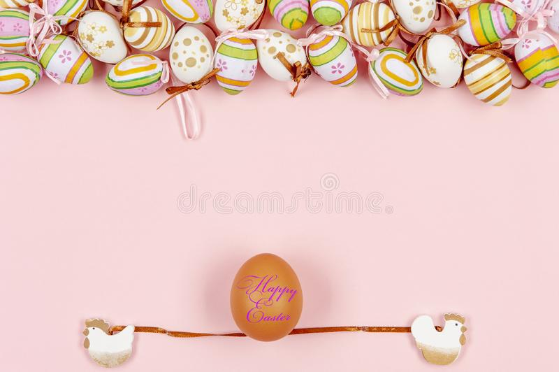 Happy easter background in the pastel color and on the wood.  royalty free stock images