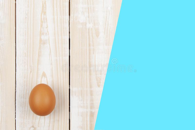 Happy easter background in the pastel color and on the wood.  royalty free stock photography