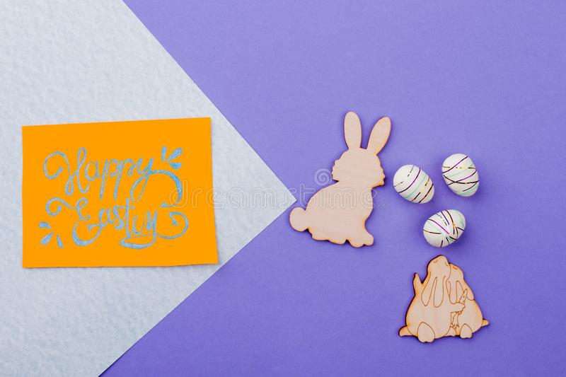 Happy Easter background with plywood rabbits. royalty free stock photography