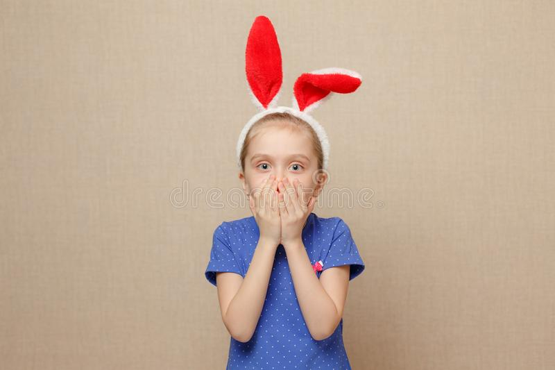 Cute little child girl wearing bunny ears on Easter day. royalty free stock photo