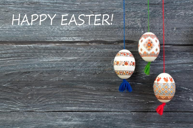 Happy Easter card. Colorful shiny easter eggs on gray wooden table background. Copy space for text. stock image