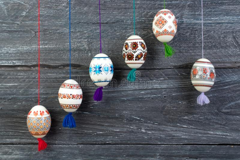 Happy Easter card. Colorful shiny easter eggs on gray wooden table background. Copy space for text. stock photos