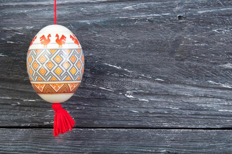 Happy Easter card. Colorful shiny easter eggs on gray wooden table background. Copy space for text. stock photography