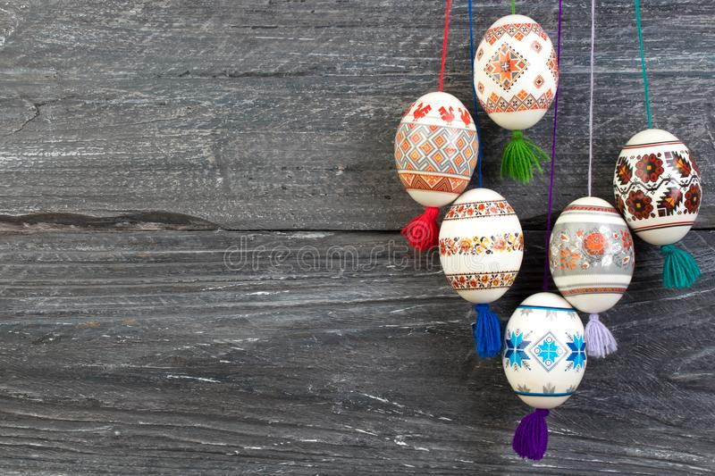 Happy Easter card. Colorful shiny easter eggs on gray wooden table background. Copy space for text. stock images