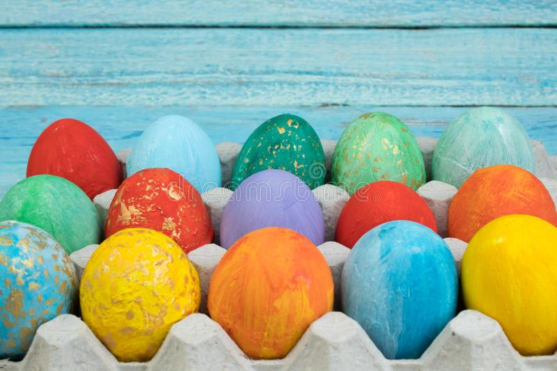 Happy Easter card. Colorful shiny easter eggs on wooden background. Copy space for text. stock photos