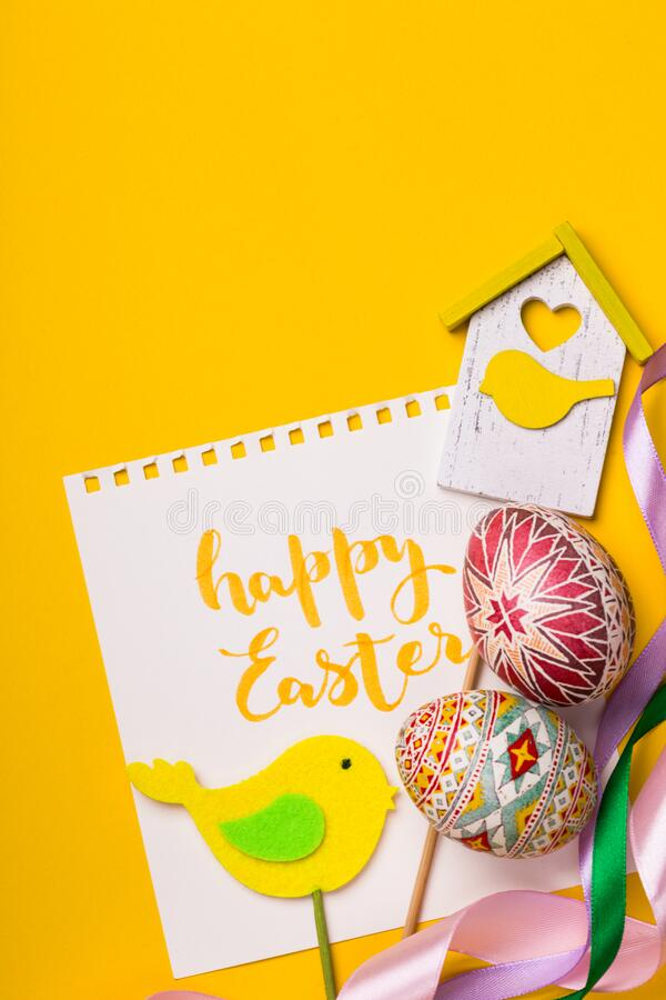 Happy easter card. Beautiful Easter egg Pysanka handmade - ukrainian traditional on a yellow background stock images