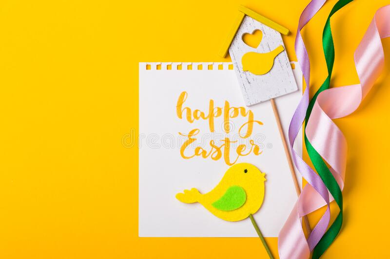 Happy easter card. Beautiful Easter egg Pysanka handmade - ukrainian traditional on a yellow background stock photo