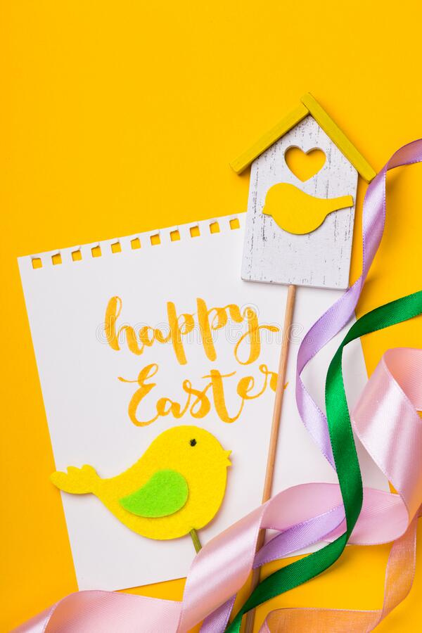 Happy easter card. On a yellow background stock image