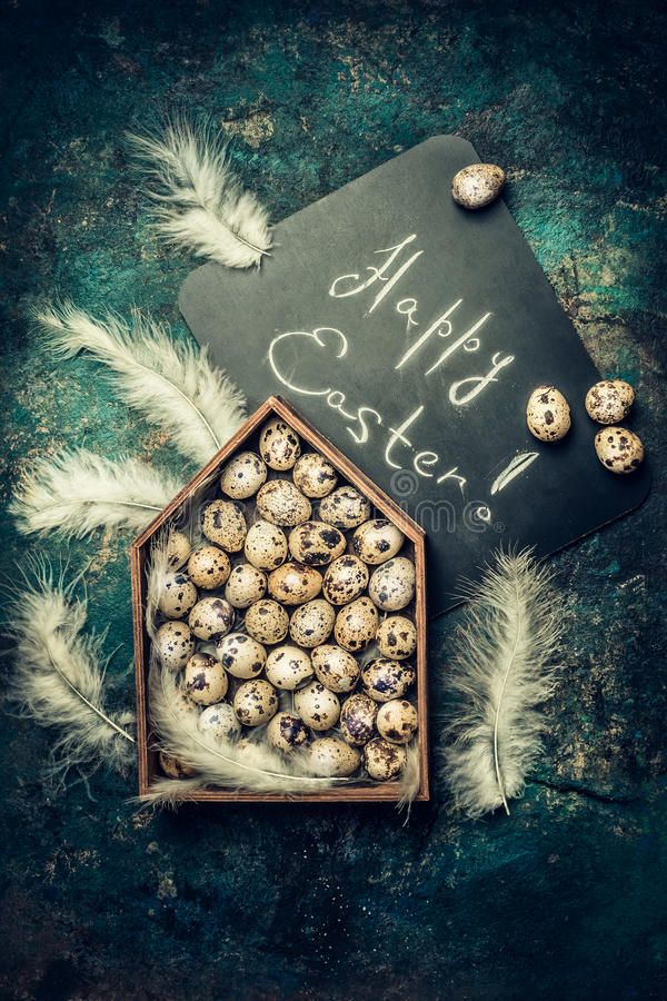 Download Happy Easter Card With  Quail Eggs And Feathers In The House Stock Photo - Image: 83703920