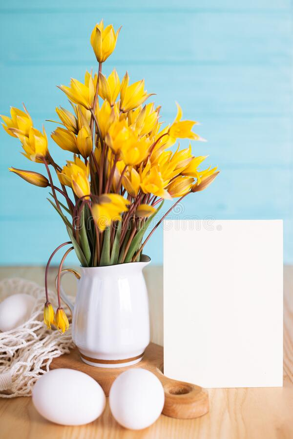 Happy easter card. Still life -  egg and bouquet of wild tulips with inscription happy easter stock photos
