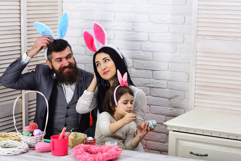 Happy easter. Childhood. Egg hunt on spring holiday. Family love easter. Mother, father and daughter paint easter eggs royalty free stock photography