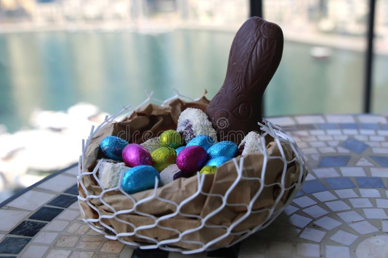 Happy Easter Chocolate Eggs A Basket Of Sweets Bunny Stock Photo