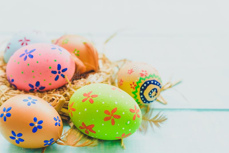 Happy easter! Colorful of Easter eggs in nest on pastel color royalty free stock image