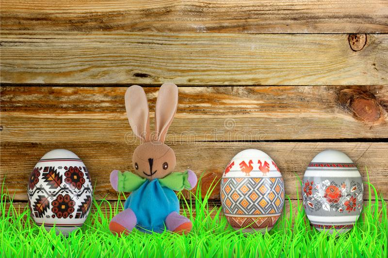 Happy Easter. Colorful easter eggs and rabbit on green grass. royalty free stock image
