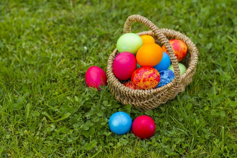 Happy Easter, colorful eggs in a basket royalty free stock images