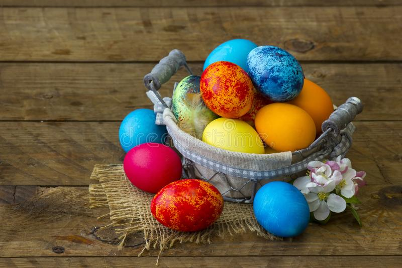 Happy Easter, colorful eggs in a basket royalty free stock photography