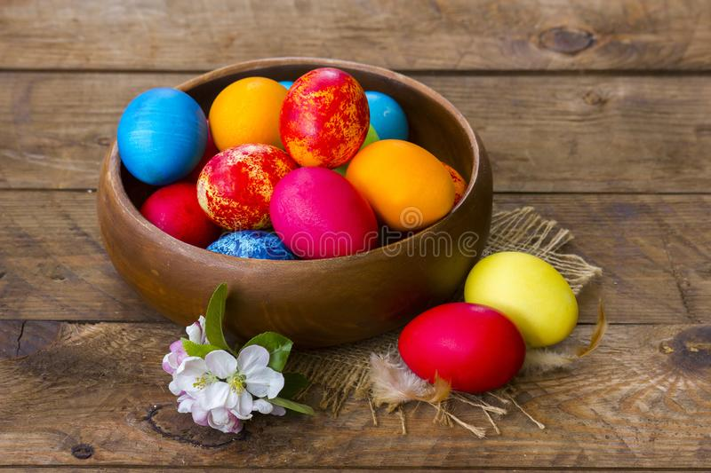 Happy Easter, colorful eggs in a basket stock photo