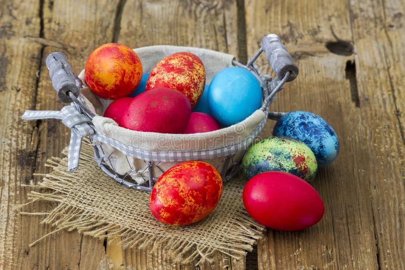 Happy Easter, colorful eggs in a basket royalty free stock photos