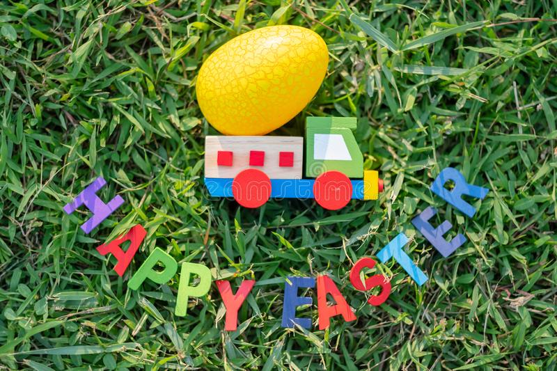 Happy Easter with Colorful Eggs cute bunny in the morning, Funny decoration in grass spring season. Happy Easter with Colorful Eggs cute bunny in the morning stock photo