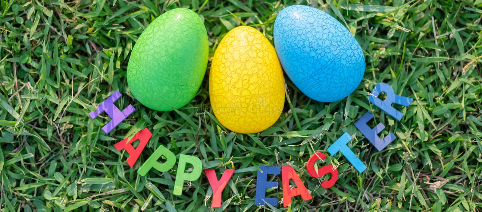 Happy Easter with Colorful Eggs cute bunny in the morning, Funny decoration in grass spring season. Happy Easter with Colorful Eggs cute bunny in the morning royalty free stock photography