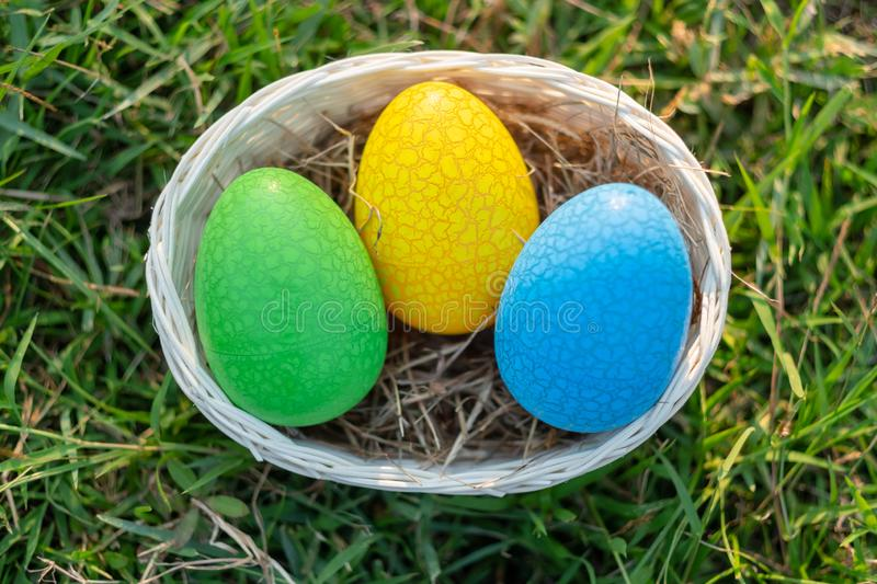 Happy Easter with Colorful Eggs cute bunny in the morning, Funny decoration in grass spring season. Happy Easter with Colorful Eggs cute bunny in the morning royalty free stock image