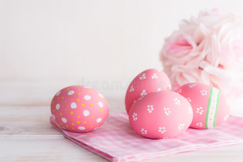 Happy easter! Colorful of Easter eggs with pink and white cheesecloth on wooden background stock photos